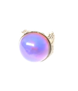 a circular mood ring showing a purple pink color mood by best mood rings