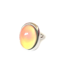 a mood ring with oval design turning a yellow orange color