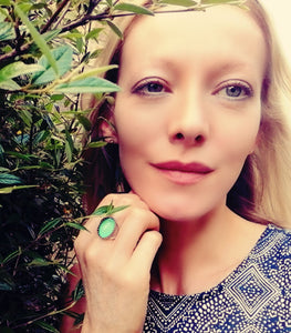model wearing mood ring turning a beautiful green color meaning