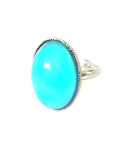 an adjustable mood ring with a turquoise color