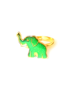 a gold elephant mood ring for children with a green color mood