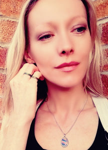 model wearing band mood rings and a oval mood pendant necklace