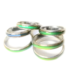 lots of band mood ring with a green mood color