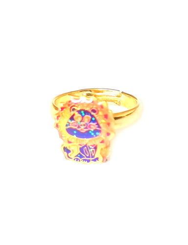 a gold colored child mood ring with a lion shape and adjustable band