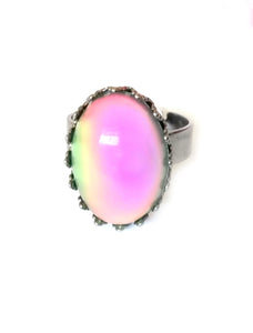 a mood ring changing color from pink mood meaning to green by best mood rings