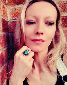 blonde model wearing a horse eye shaped mood ring with adjustable band