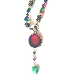 a magnetic mood ring with a circular mood bead and hearts
