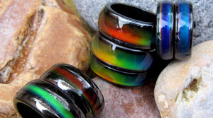 magnetic mood rings lying on the beach by best mood rings