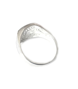 the back of a men's mood ring showing engraving