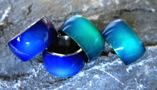 Load image into Gallery viewer, wider stainless steel band mood rings showing a blue and green color