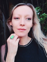 Load image into Gallery viewer, blonde model wearing a large mood ring with a green color mood