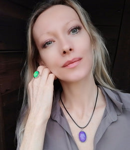 model wearing an oval mood necklace with black cord and an adjustable mood ring