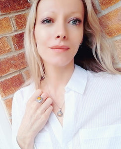 model wearing mood necklace and mood ring in a white shirt