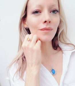 blonde model in white shirt wearing celtic silver mood ring and a silver mood locket necklace