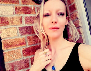 beautiful model wearing silver mood ring and silver mood locket