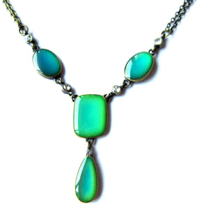 mood necklace with green colored moods