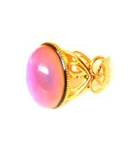 Load image into Gallery viewer, mood ring with a gold band with a pink mood
