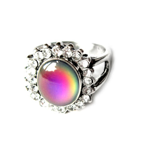 an antique style mood ring with beads around the sides