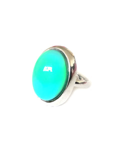 an oval mood ring with a silver plated adjustable band