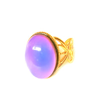 Load image into Gallery viewer, a mood ring turning purple set on a golden shade adjustable band