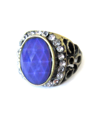 bronzed mood ring with a purple mood