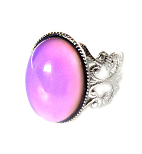 oval brass mood ring with pink mood color