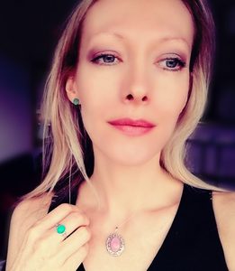 model wearing mood earrings, a silver mood ring and a silver mood locket pendant by best mood rings