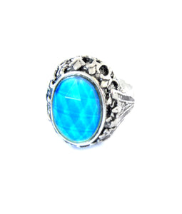 an adjustable mood ring turning a blue color