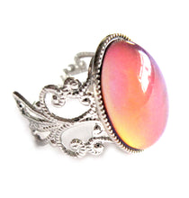 Load image into Gallery viewer, oval mood ring with orange mood meaning and silver shade brass band