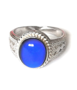 a sterling silver ring showing a blue color