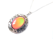 Load image into Gallery viewer, a sterling silver oval mood pendant locket with a silver chain