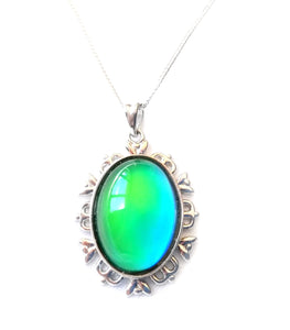 sterling silver mood pendant necklace with an oval mood turning a green mood color
