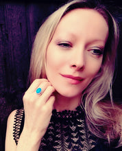 Load image into Gallery viewer, a model wearing a sterling silver mood ring by best mood rings