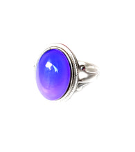 Load image into Gallery viewer, a sterling silver mood ring with a purple mood color