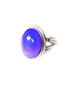 a sterling silver mood ring with a purple mood color
