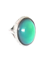 Load image into Gallery viewer, sterling silver mood ring with an oval mood showing a beautiful green color mood meaning