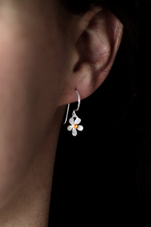 Silver flower drop earrings with gold plated centre