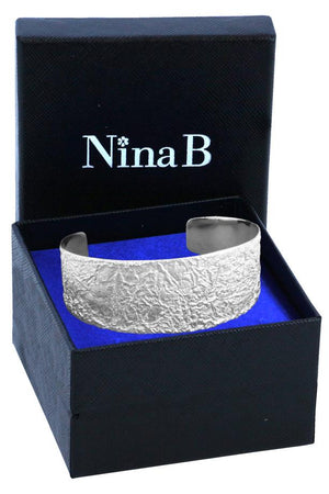 Silver textured lunar surface cuff bangle