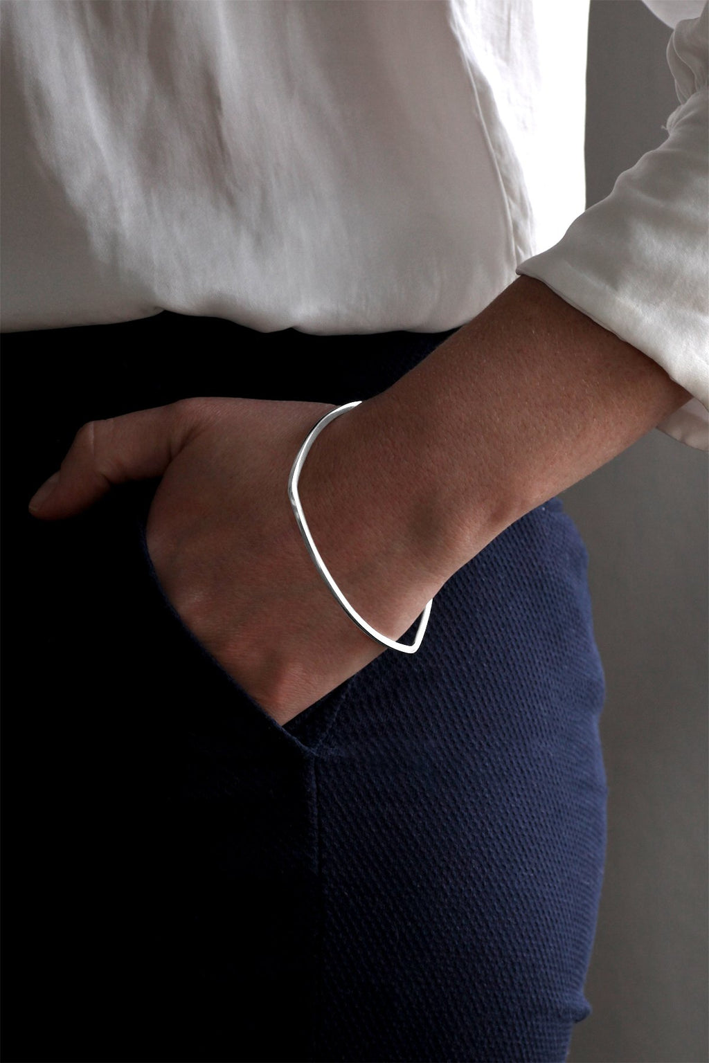 Curved Triangle Silver Bangle