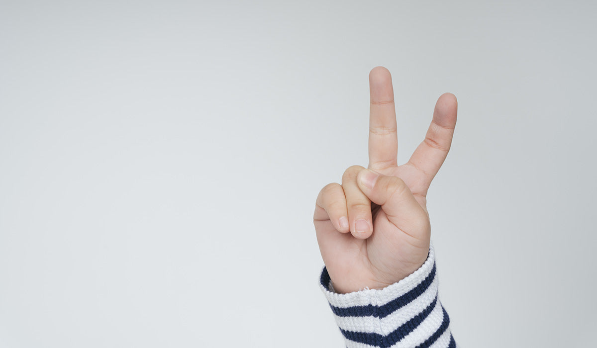 Child holding up two fingers