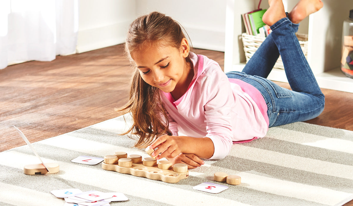 Girl counting wooden blocks