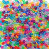 Rainbow glitter colors of 6 x 9mm Plastic Pony Beads