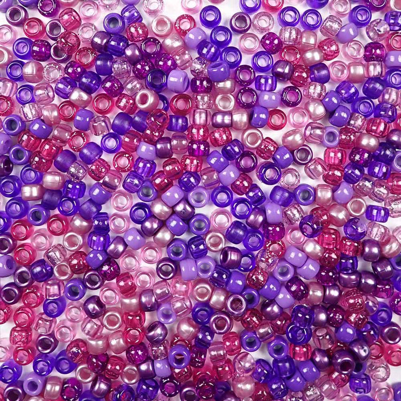 a mix of violet and purple colors of 6 x 9mm plastic pony beads