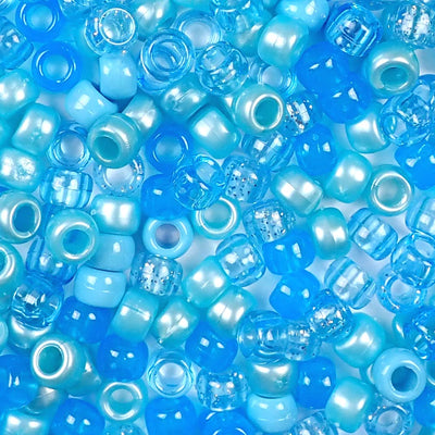a mix of light blue colors of 6 x 9mm plastic pony beads