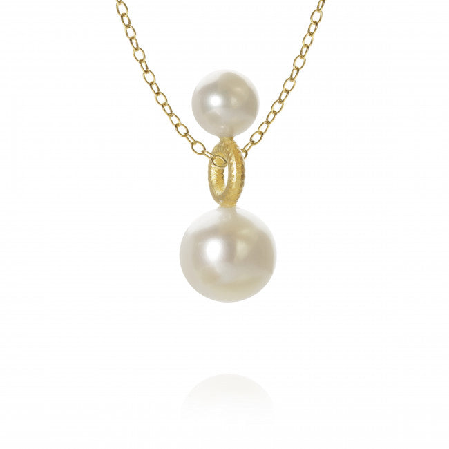 Balance pendant with freshwater pearl.