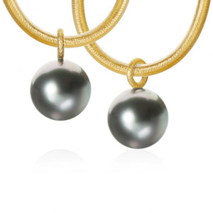 Globe pendants with large Tahitian pearls.