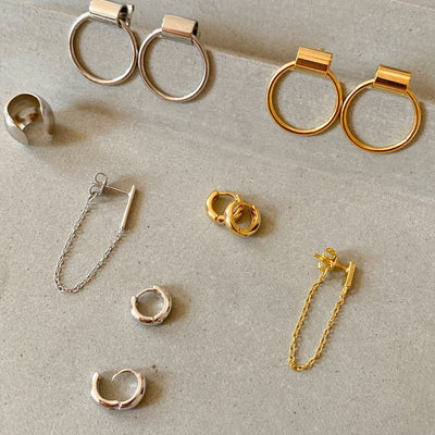 Shop our cult classic collection which features gold and silver jewelry. Shop our bea hoop, bar jacket, orb ear cuff, and small swing hoop.