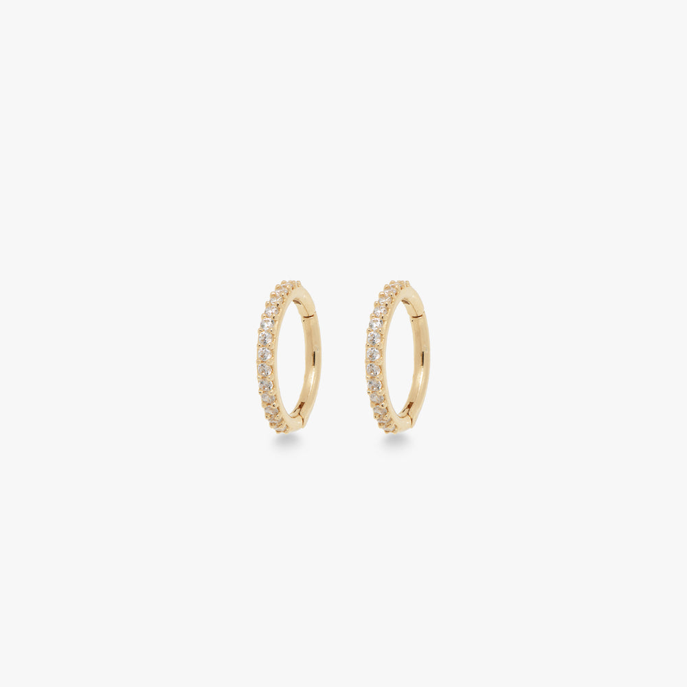 This clicker is a small 14k gold hoop with CZ front accents that measures at 8mm. [pair] color:gold/clear