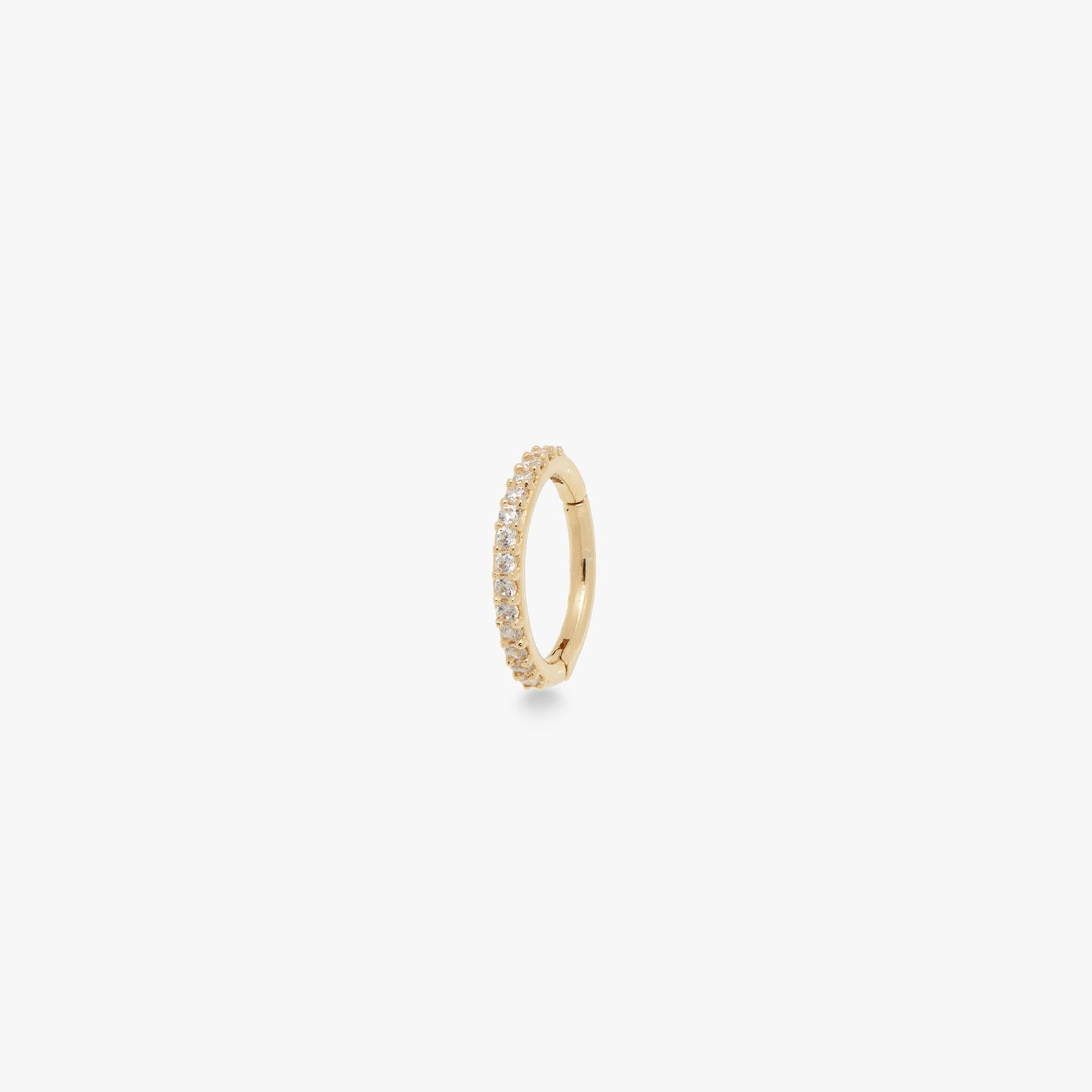This clicker is a small 14k gold hoop with CZ front accents that measures at 8mm. color:gold/clear