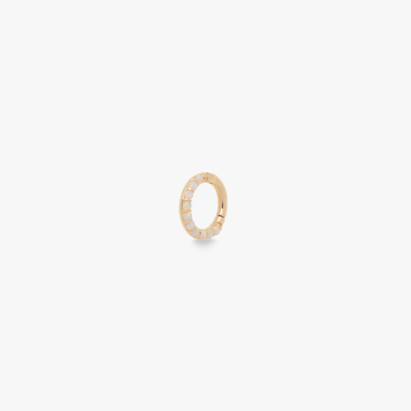 This clicker is a small 14K gold hoop with opal front accents that measures 6mm.